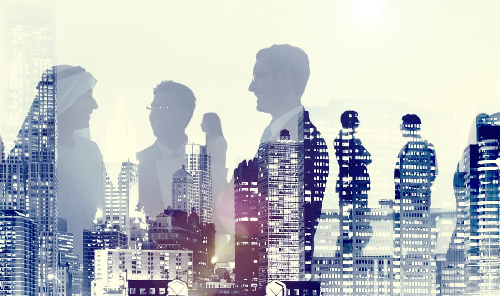 two men and woman figures standing in front of a busy city skyline made of silhouettes of their partners in office